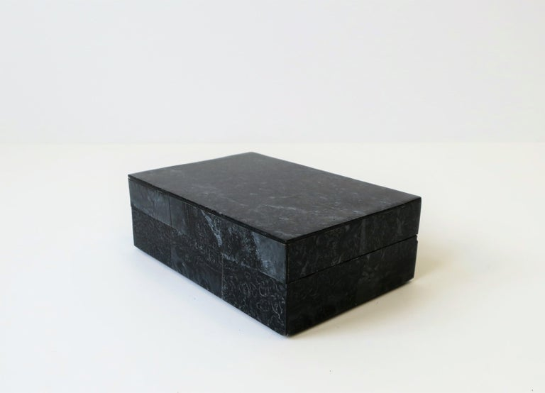 A beautiful black pearlized veneer decorative, jewelry, vanity or trinket box, with a wood lined interior.  Box measures: 4.25