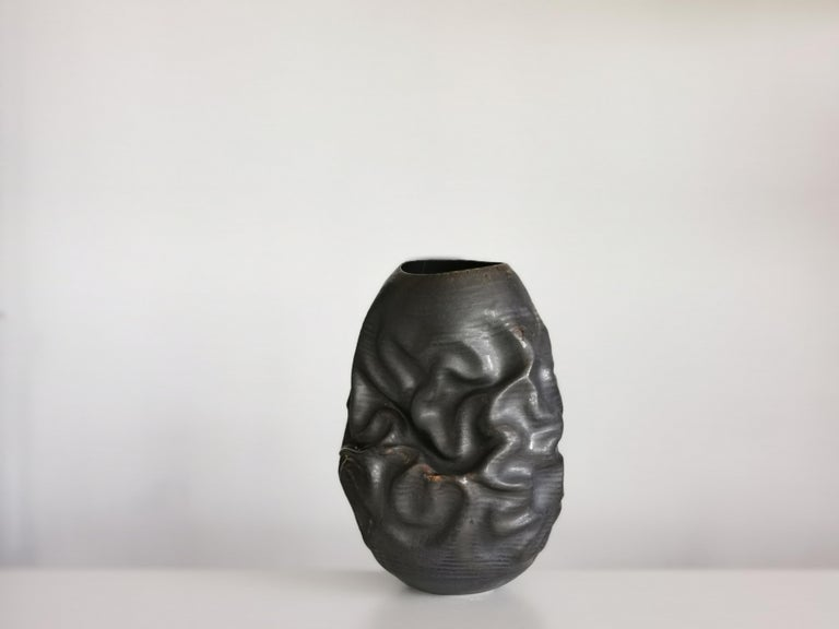 New sumptuous ceramic vessel from ceramic artist Nicholas Arroyave-Portela.  Materials. White St. Thomas clay. Stoneware glazes. Multi fired to cone 9 (1260-1280 degrees)  The artist starts out by throwing his creations on the wheel using a