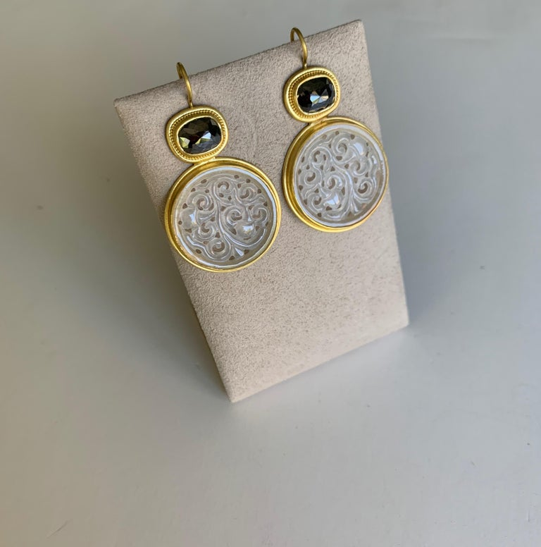 Stunning earrings in delicately carved Icy Jadeite and rose cut black Diamonds, set in 22 Karat gold and enhanced with fine granulation. The rose cut diamonds are 7 x 9 millimeters and weigh 4.91 carats The Jadeites are 24mm diameter by 2.5mm