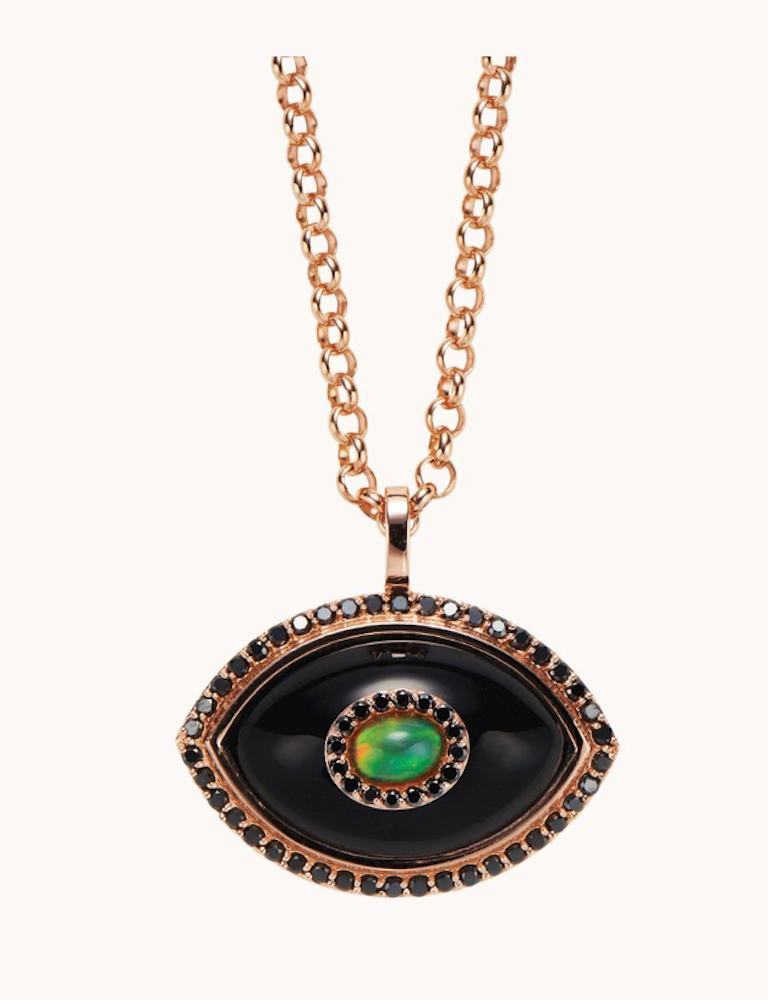 An ancient talisman originating from the near east, The Marlo Laz iconic Eyecon series revisits the evil eye with our own sculptural, ornate perspective and an ode to surrealism. Black onyx for protection, black diamonds for strength, and opals for