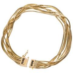 Black Diamond Paveè and 18 Karat Yellow Gold Multi Strand Bracelet Iosselliani