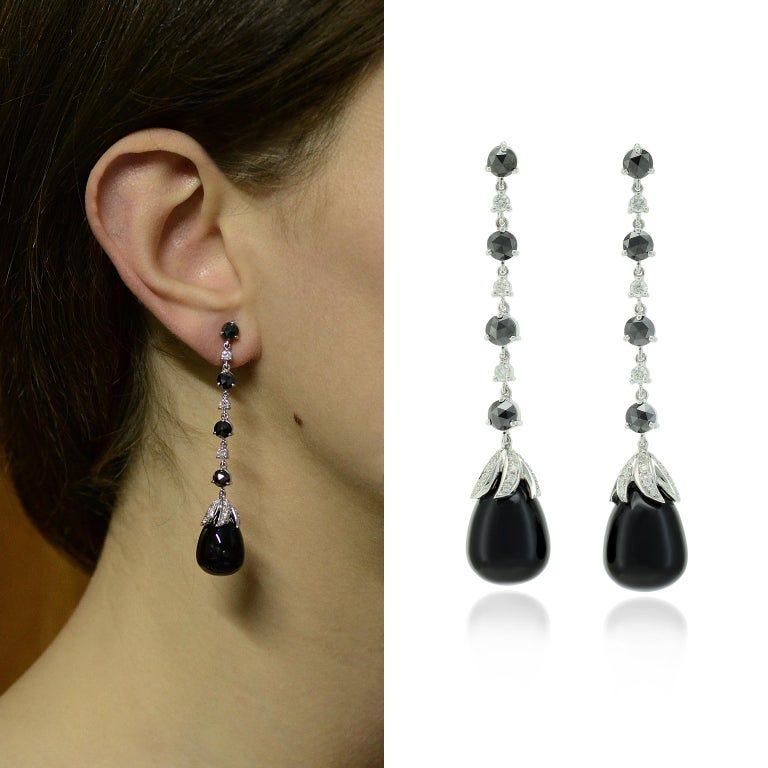 Handcrafted in Italy, in Margherita Burgener family workshop, the flexible long earrings feature a rose cut black diamond alternate to a colorless round diamond, ending by a onyx cabochon drop with diamond pavé set leaves motif.   Fitting and
