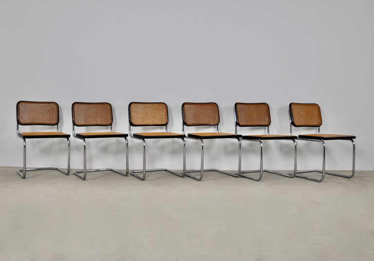 Set of 6 chairs in metal, wood and cane. Wear due to time and age of the chairs (see photo)  Measure: Seat height: 46cm.