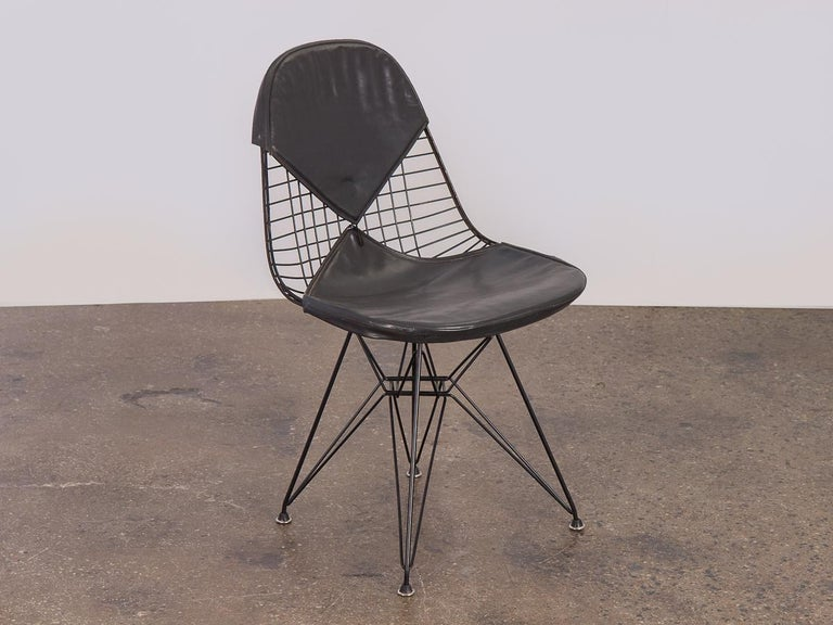 Awesome Classic black Eames wire chair on a black eiffel base with the bikini cover for Herman Miller. The bikini cover is missing the button and has a tear in the right front corner, but is soft and pliable to the touch. A lovely desk chair for