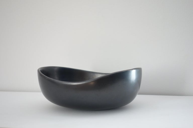Black enameled ceramic bowl by Georges Jouve, circa 1950. Perfect original condition. Artist's cypher under the base.  Provenance: Private collection for the South of France.  Literature: -