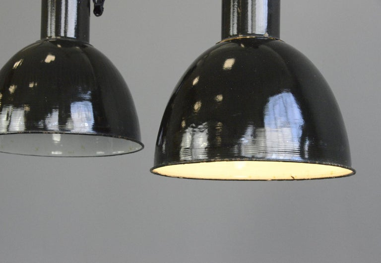 Black enamel Bauhaus Factory lights, circa 1930s  - Price is per light - Vitreous black enamel shades - White enamel inner reflectors - Cast iron tops - Comes with 100cm of black braided cable - Comes with chain and ceiling hook - Takes E27