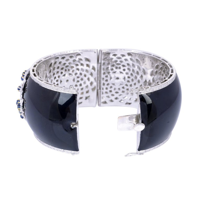 A beautiful enamel bracelet cuff handmade in 14K gold and sterling silver.  It is set in 3.0 carats sapphire and 2.72 carats of sparkling diamonds. Clasp Closure.  FOLLOW  MEGHNA JEWELS storefront to view the latest collection & exclusive pieces.
