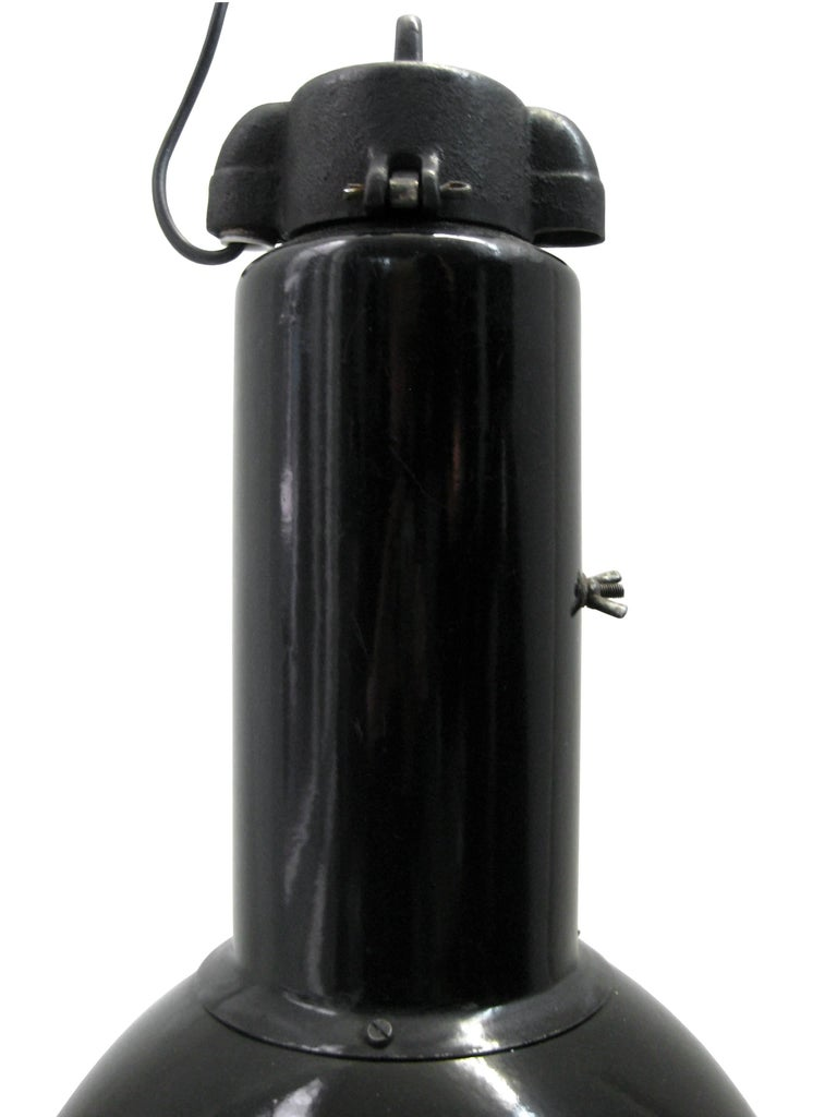Bauhaus Classic from the 1930s. Black enamel Industrial hanging lamp. Cast iron top. White interior.  Weight: 3.0 kg / 6.6 lb  Priced per individual item. All lamps have been made suitable by international standards for incandescent light