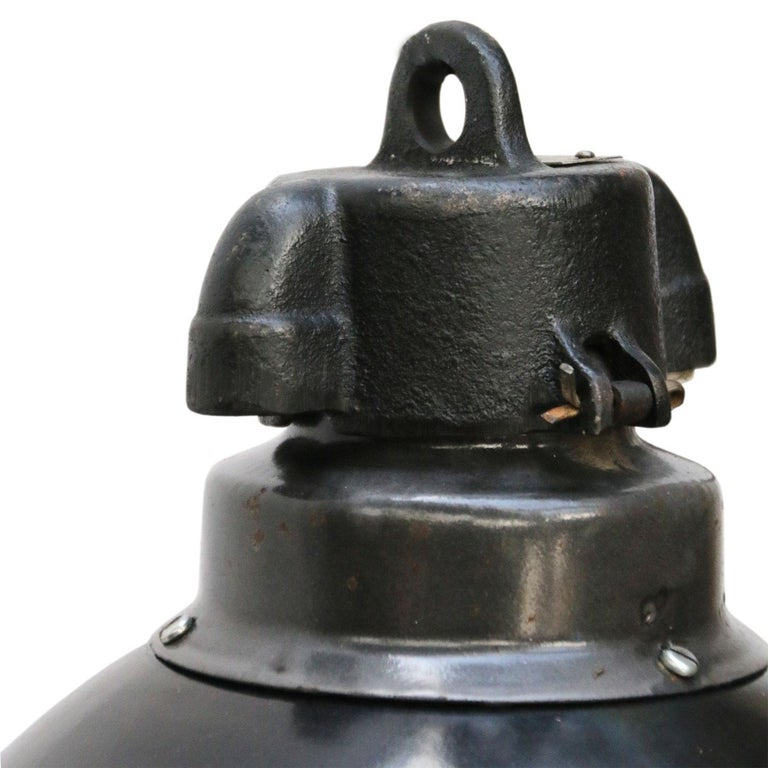 Bauhaus Classic from the 1930s. Black enamel Industrial hanging lamp. Cast iron top. White interior.  Weight: 1.7 kg / 3.7 lb  Priced per individual item. All lamps have been made suitable by international standards for incandescent light bulbs,
