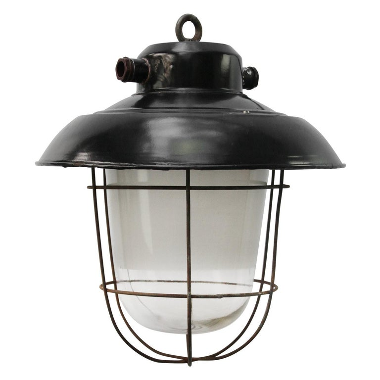 Black enamel industrial lamp. Clear glass with frosted semitransparent stripe in middle. For use outdoors as well as indoors.   Weight 3.0 kg / 6.6 lb.   Priced per individual item. All lamps have been made suitable by international standards
