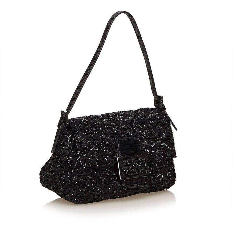 Product details:  Black beaded wool baguette shoulder bag by Fendi.  Single shoulder strap.  Front flap with magnetic snap closure.  Lined interior with inner slide pocket.  Silvertone hardware.  6