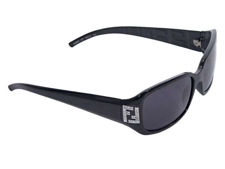 Product details:  Black rectangular sunglasses by Fendi.  Rhinestone embellished logo at temples.  Tapered stems.  2