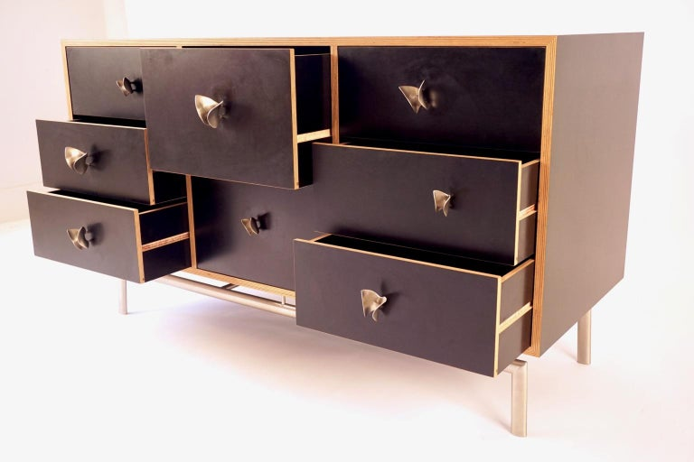 The butterfly cabinet is one of a group of pieces Lehrecke designed while working with the E.R.Butler hardware company in 2009. Most of the pieces involved knobs of his own design for the company, but in this piece we used the Ted Muehling designed