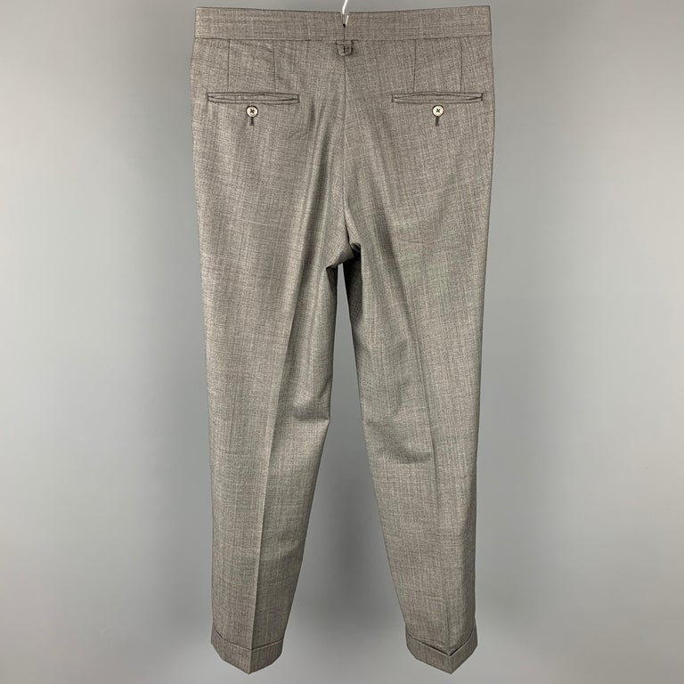 BLACK FLEECE dress pants comes in a grey heather wool featuring a flat front, front tab, and a zip fly closure. Made in USA.  Very Good Pre-Owned Condition. Marked: BB1  Measurements:  Waist: 32 in. Rise: 11 in. Inseam: 32 in.