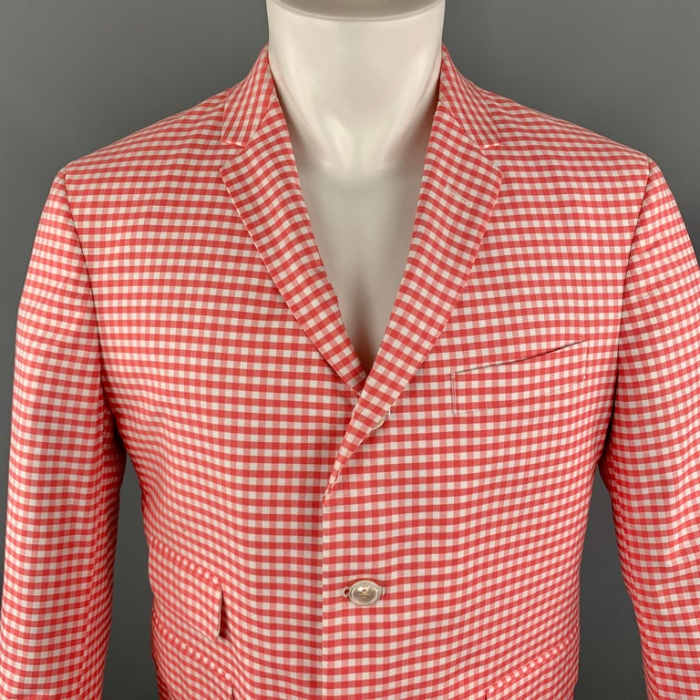 BLACK FLEECE Sport Coat comes in coral and white tones in a checkered cotton material, with a notch lapel, three buttons at closure, single breasted, slit pockets, unbuttoned cuffs, a single vent at back, unlined.    Excellent Pre-Owned