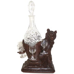 Black Forest Carved Bear Liquor Tantalus Stand and Wine Decanter Set, circa 1895