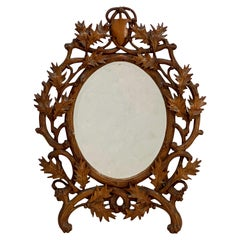 Black Forest Carved Frame Oval Beveled Mirror from Switzerland (H 17 x W 13)