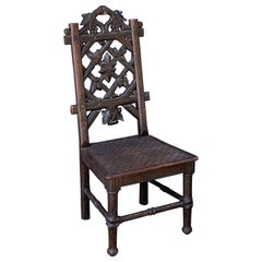 Black Forest Chair of Carved Oak from the 19th Century