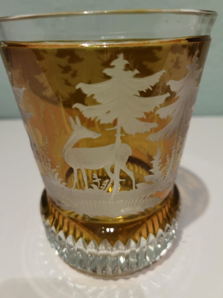 Hand blown crystal latern in amber glass from Bavaria. The votiv is hand blown and the decor is hands-free engraved by glass artists all around with a hunting scene with trees and deers in the style of Black Forest. Sofina glass and porcelain was