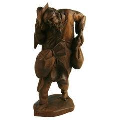 Black Forest Hand Carved Walnut Figural Traveler Sculpture