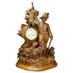 Black Forest Mantel Clock with Hunter Presenting His Hunted Game