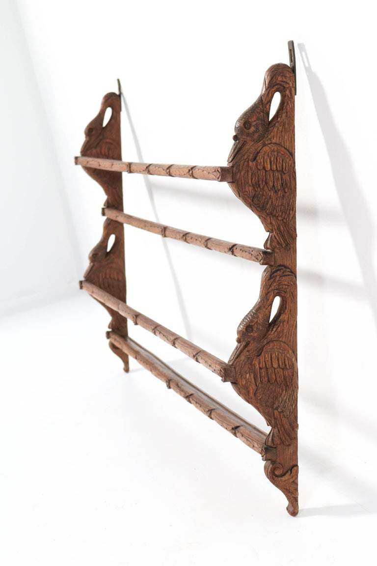 Wonderful and rare Black Forest plate rack. Striking German design from the 1900s. Solid oak with amazing hand carved geese figure. In very good condition with minor wear consistent with age and use, preserving a beautiful patina.