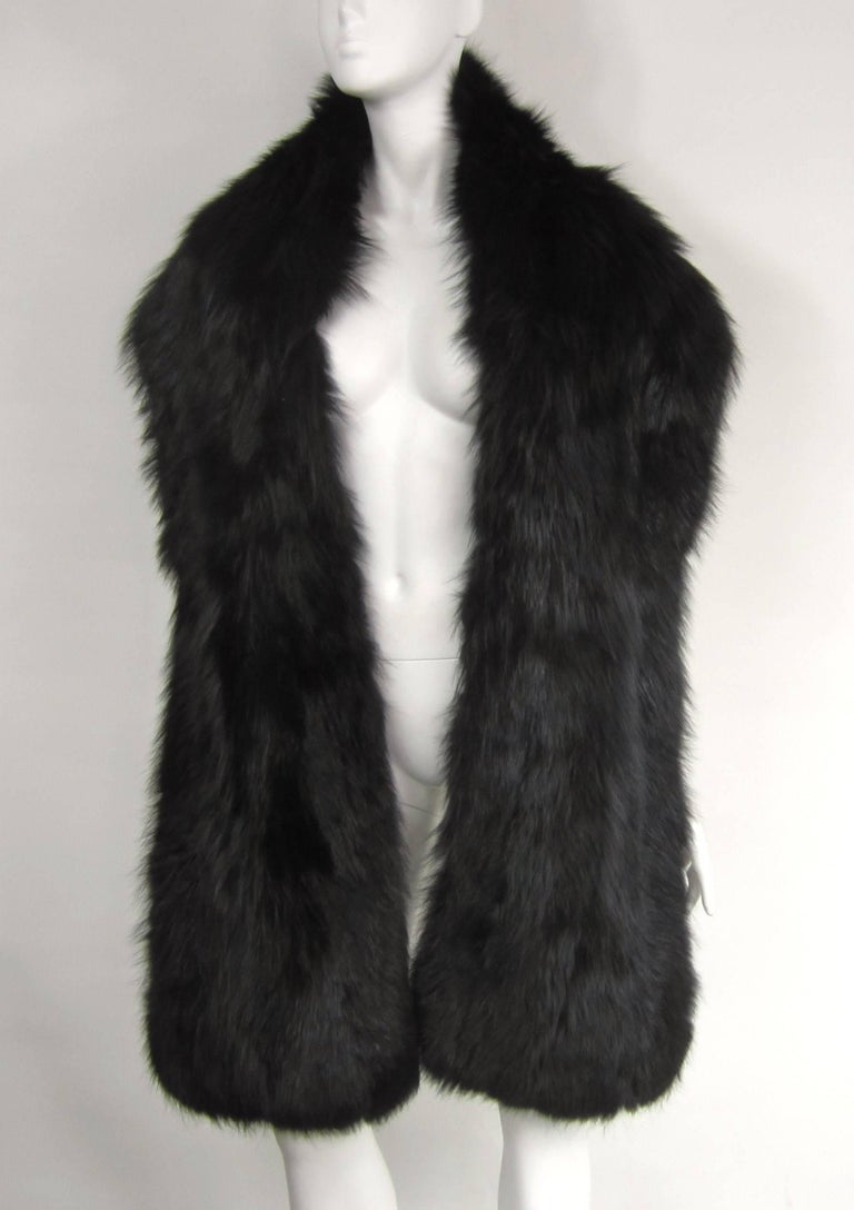 Long luscious Black Fox Wrap. Measuring 88 inches long x 11 inches at the widest. Versatile in style, wearing over a couture gown or over a jacket and jeans. Fur is supple.  We have been selling on this platform since 2013 so be sure to check our