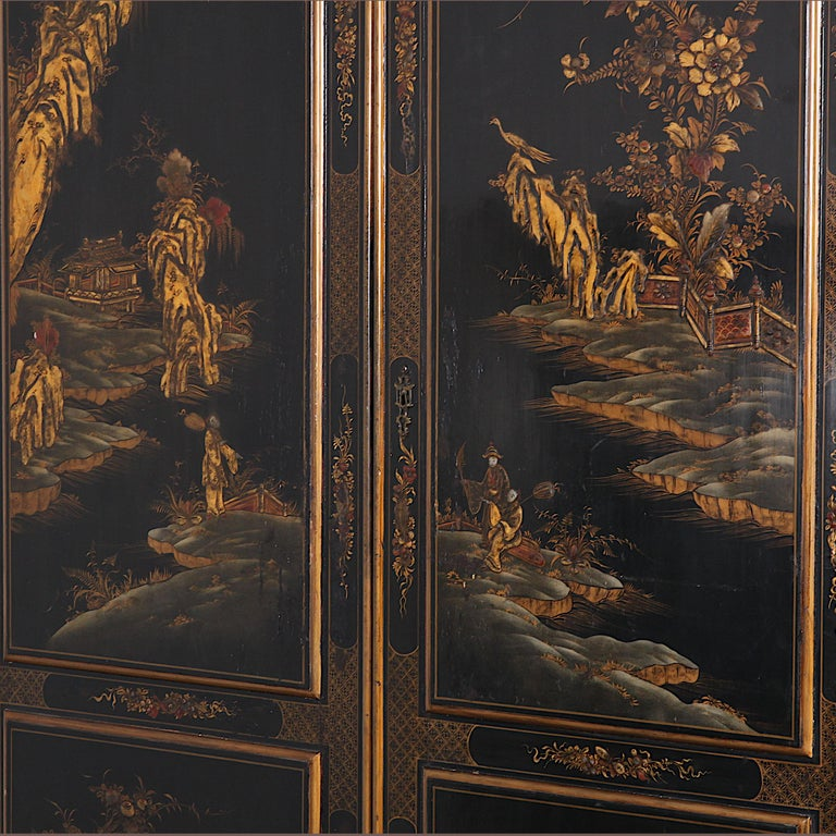 Black and gilt lacquered chinoiserie or 'Japanned' armoire with polychrome and gilt scenery of figures in various landscape settings. Beautifully detailed and a wonderful decorative piece in all settings.