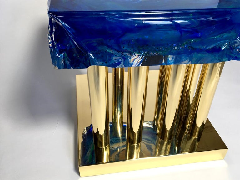 Coffee table in plexiglass with sixteen brass legs designed and produced by Studio Superego.  Biography Superego Editions was born in 2006, performing a constant activity of research in decorative arts by offering both contemporary and vintage