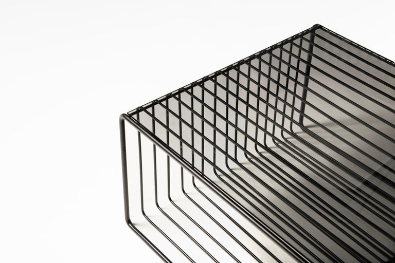 """Black Kaleidoscope low coffee table: A low floor table is design with minimal materials, tinted glass and black steel. This created compositional illusion, playing with positive and negative shapes.  Black Kaleidoscope """"Living"""" collection"""