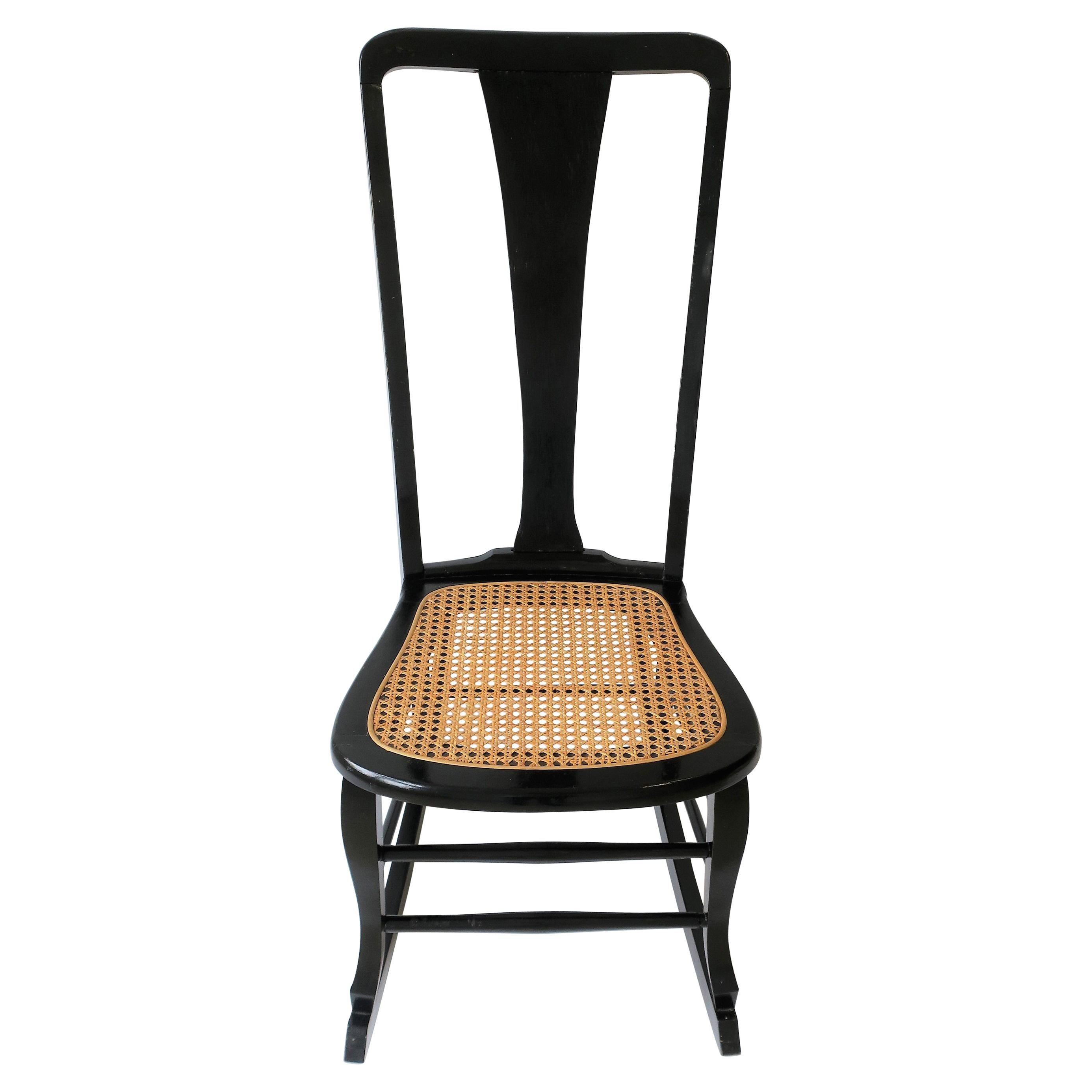 Black Lacquered Wood and Cane Rocking Chair