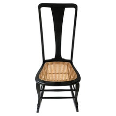 Black Lacquer and Cane Rocking Chair