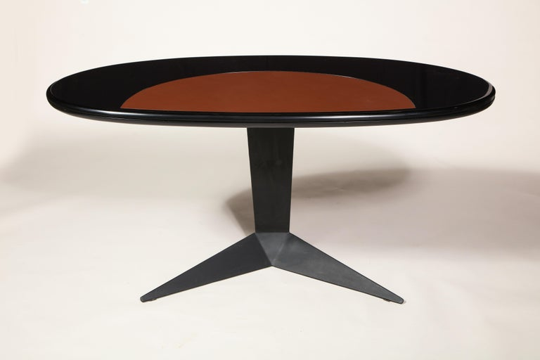 Black lacquer and steel oval desk console entry table, France, circa 1960s  Beautiful desk or entry table with an oval lacquer wood black top with brown leather detail. The lacquer is in very good condition with no chips or cracks visible. The