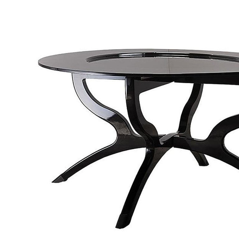 Coffee table black lacquered with hand carved solid wood structure in black lacquered finish.