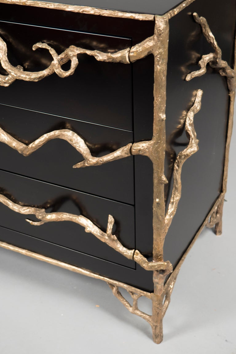 Matte black lacquered wooden body with three wide drawers, decorated with bronze branches throughout. Custom sizes and finishes available.