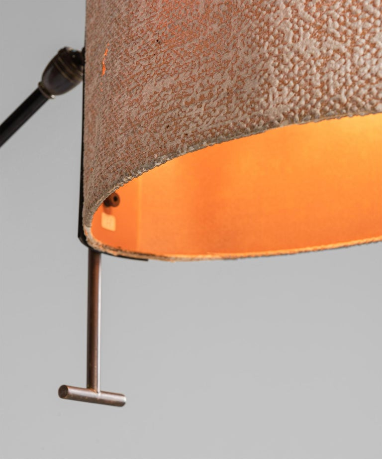 Cast Black Lacquered & Gilt Brass Floor Lamp by Maison Lunel, France, circa 1950 For Sale
