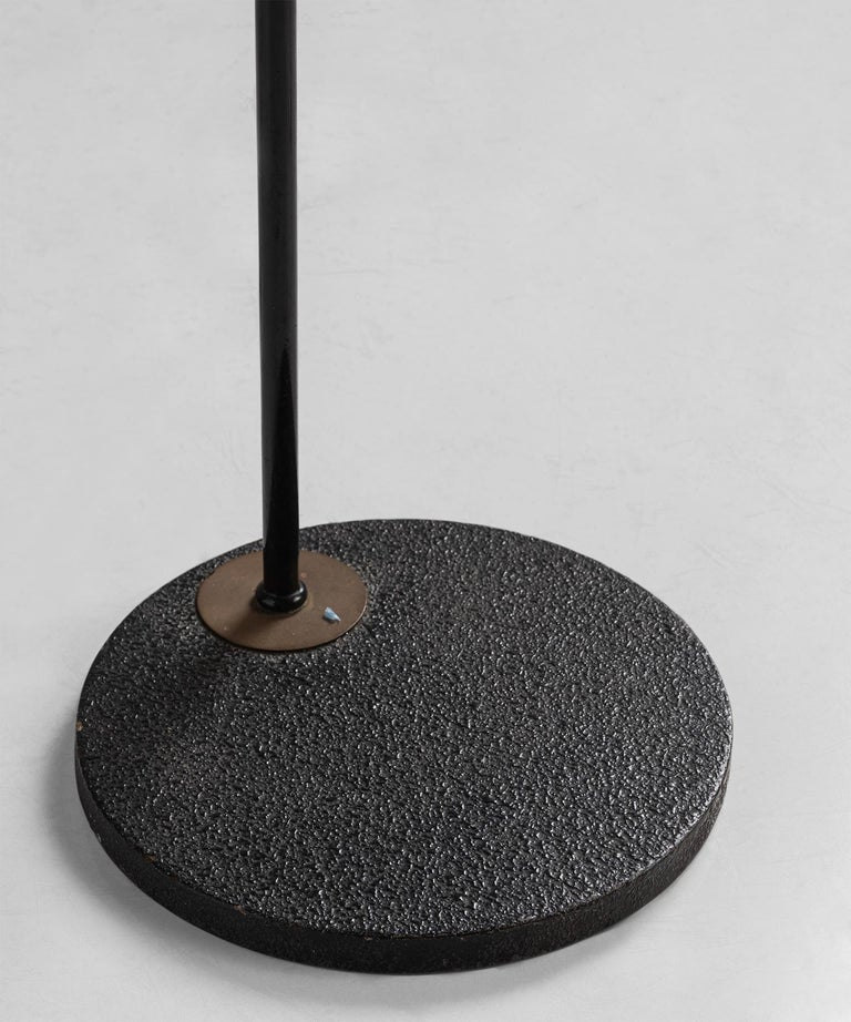Mid-20th Century Black Lacquered & Gilt Brass Floor Lamp by Maison Lunel, France, circa 1950 For Sale