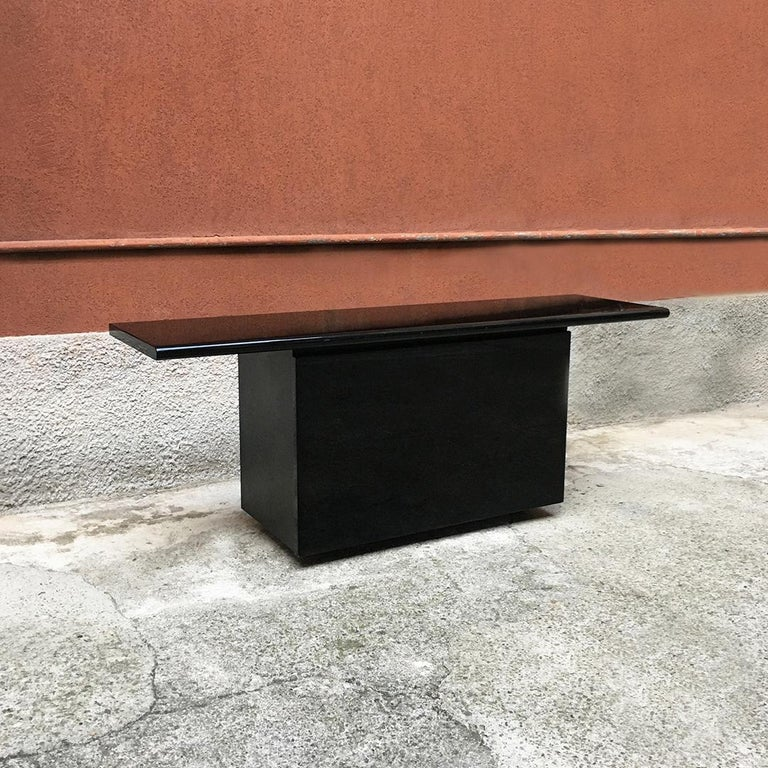 Black lacquered Sheraton sideboard by G.Stoppino and L.Acerbis by Acerbis, 1977 Space Age Sheraton sideboard with black lacquered wooden surface, with original period finish. Single container with sliding opening, glass shelves, internal drawers