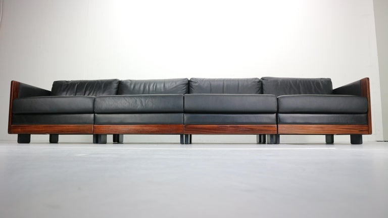 Four-seat sofa was produced by Cassina in 1960s and designed by Afra and Tobia Scarpa. Mid-Century Modern period Italian design peace. Rosewood frame with a high quality black leather covering the sides and back, seating and back cushions. Model