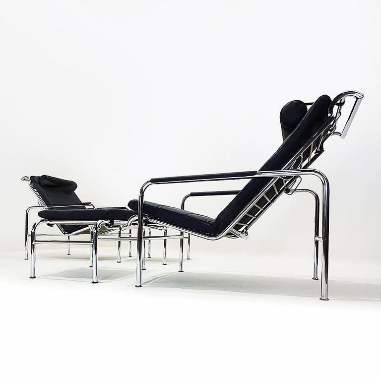 An outstanding pair of black leather and chrome Genni reclining lounge chairs with matching ottomans originally designed by Gabriele Mucchi in 1935.  The pair are in excellent vintage condition save a couple of marks in the chrome on the front of