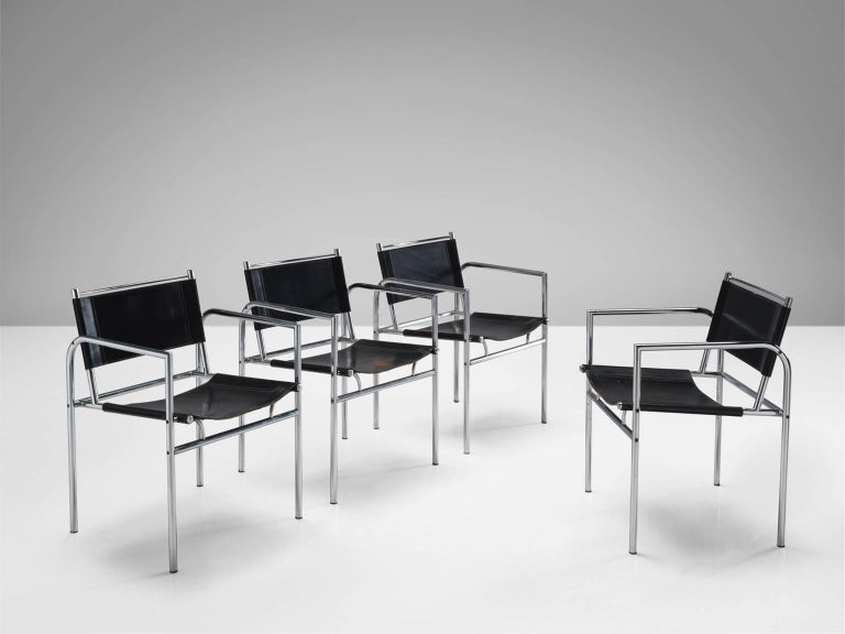 Armchairs, in stainless steel and leather, Netherlands, 1960s.   Set of four black leather chairs with metal tubular steel. This set is characterized by clear lines and the use of metal in combination with the black natural material. The frame of
