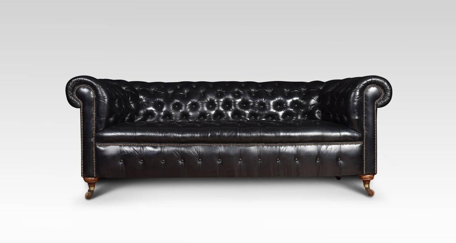 Large Three Seat Black Leather Chesterfield Sofa, Having Deep Buttoned Back  And Seat,