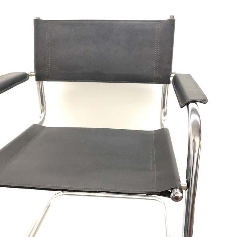 Modern vintage black leather chair cantilever tubular chrome steel frame for a desk, dining, office, living room or waiting area. The armchair is a beautiful midcentury furniture of the Bauhaus era designed in Germany.