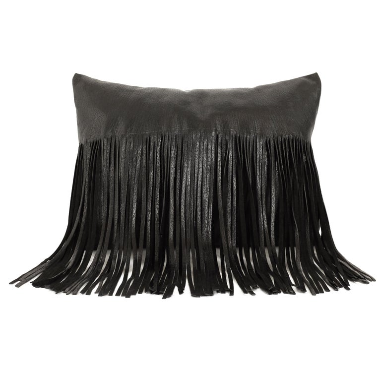 Designed to add flair, this handmade supple leather pillow has a smooth top that gracefully transforms into long hanging leather fringe adornment.  Also customizable a range of colors and sizes. Style no. ICU1603-SNG-TP. Production time 3-4 weeks.