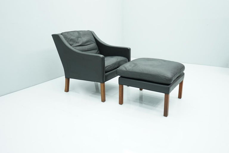 Scandinavian Modern Danish Lounge Chair with Stool by Børge Mogensen in Black Leather, 1960s For Sale