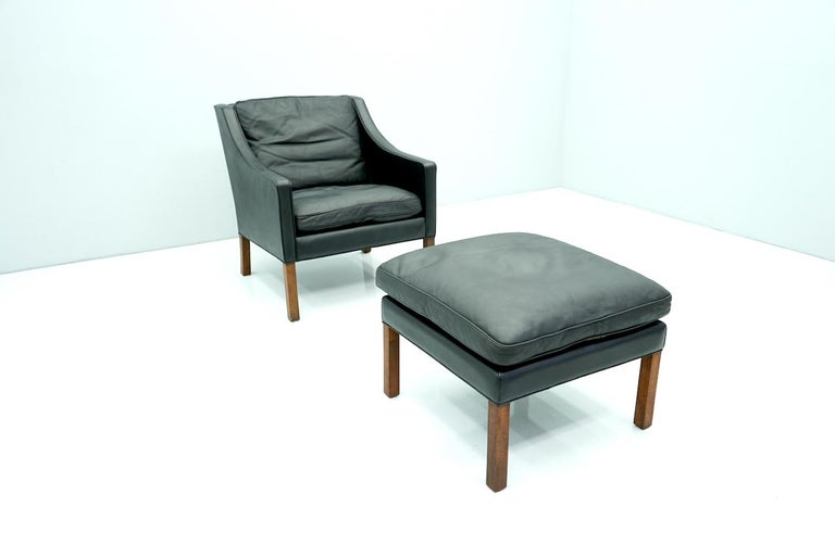 Mid-20th Century Danish Lounge Chair with Stool by Børge Mogensen in Black Leather, 1960s For Sale