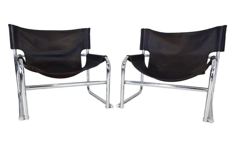 Vintage late midcentury black leather T1 sling lounge chairs by Rodney Kinsman for OMK.  Kinsman trained at the Central School of Art and in 1966 founded OMK furniture with partners Jurek Olejnik and Bryan Morrison in 1966, the company name being