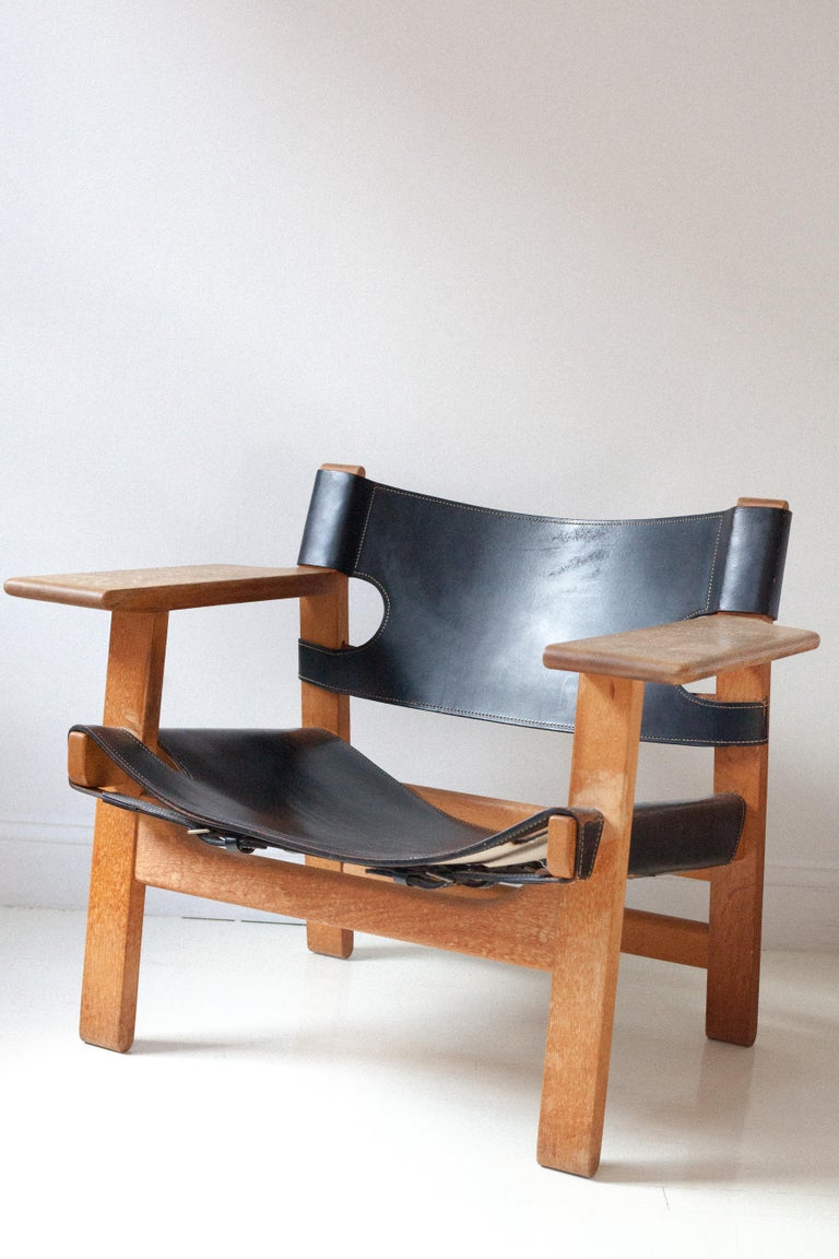 A rare example of Børge Mogensen's oak Spanish chair in black leather.