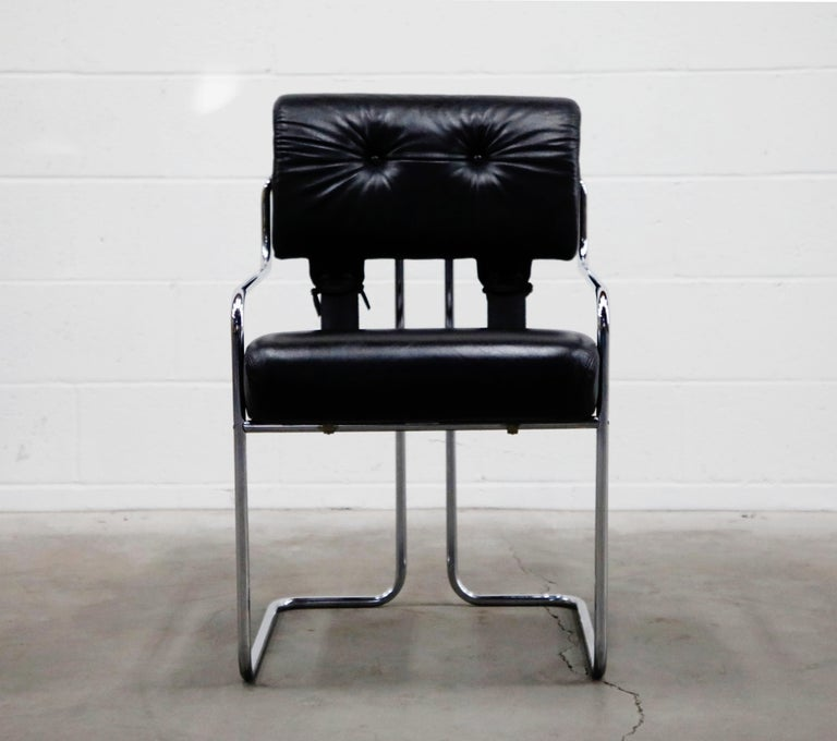 Currently, the most coveted dining chairs by interior designers are 'Tucroma' chairs by Guido Faleschini for i4 Mariani, and we have this incredible set of two (2) Tucroma armchairs in beautiful black leather with polished chrome frames. The seats