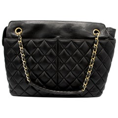 Black Leather Vintage Chanel with Leather and Gold Colored Chain Strap